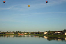 Balloons over the lake at sunrise