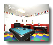 "Games room with 62"" TV"